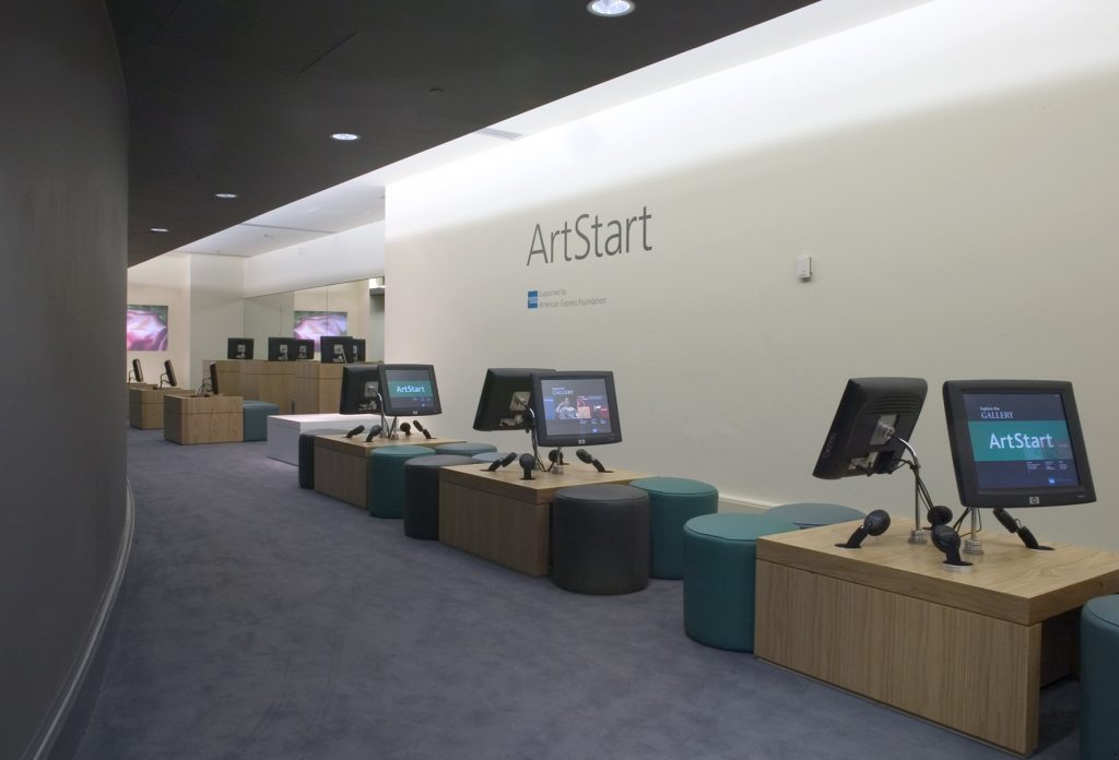 The National Gallery's ArtStart Room, showing a series of collection information touch-screen kiosks with audio wands, and leather stools.