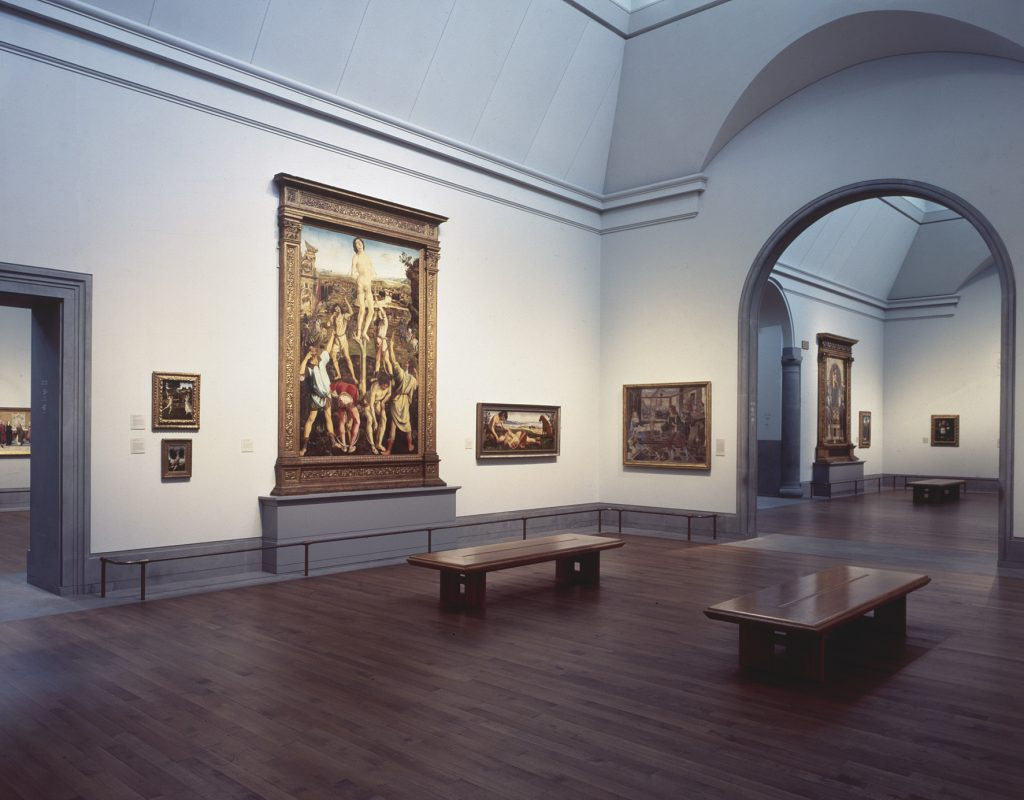 Room 59 in the National Gallery's Sainsbury Wing, 1991, showing Italian renaissance paintings by Gherardo di Giovanni del Flora, the Pollaiuolo brothers, Piero di Cosimo, and Pinturicchio.